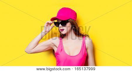 Elegant Brunette Woman In Pink Swimsuit And Fashion Cap. Sexy Lady In Pink Beachwear, Sunglasses Enj
