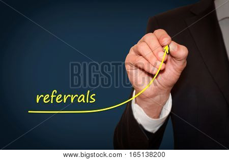 Businessman draw growing line symbolize growing referrals