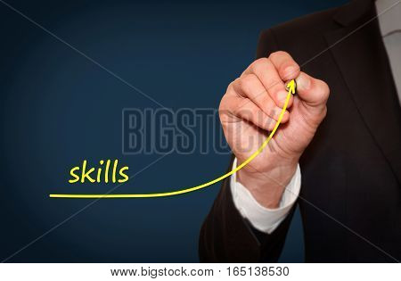 Businessman draw growing line symbolize growing Skills