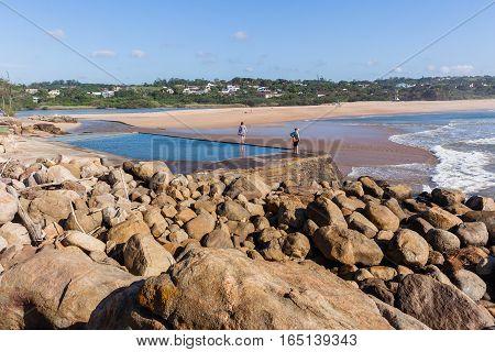 Southbroom beach women walking exploring tidal pool river lagoon ocean waves scenic landscape