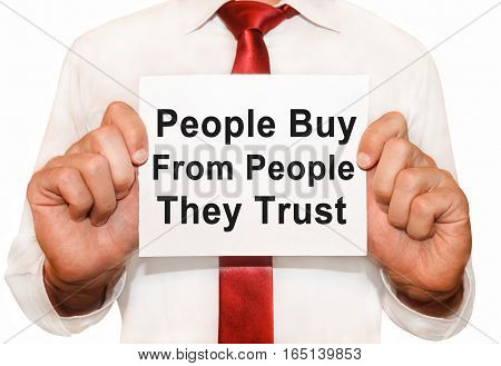 Man Holding A Card With A Text People Buy From People They Trust.