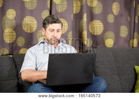 Teleworking Caucasian Man In Home Office