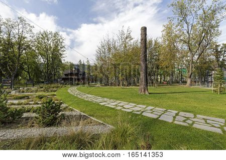 ZAKOPANE POLAND - SEPTEMBER 23 2016: Alley arranged with stones runs through the city park named Marshal Jozef Pilsudski the revitalization of the park was completed in 2013