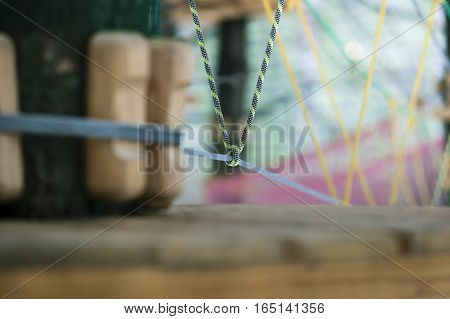 Rope park in the city. Knot and connection of insurance closeup