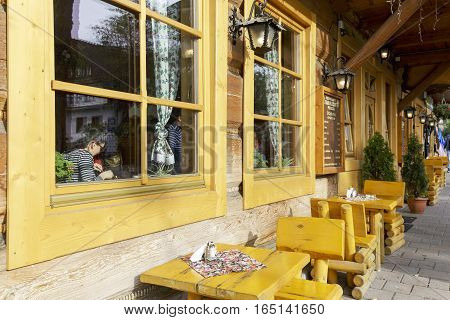 ZAKOPANE POLAND - SEPTEMBER 23 2016: Front facade of Villa Marysin that was built of wood in 1897 on the ground floor runs the well known among tourists a milk bar. This villa was renovated in 2014