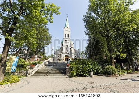 ZAKOPANE POLAND - SEPTEMBER 12 2016: Holy Family Church that was built in 1879-1896 in the Romanesque Revival style by architect Jozef Pius Dziekonski