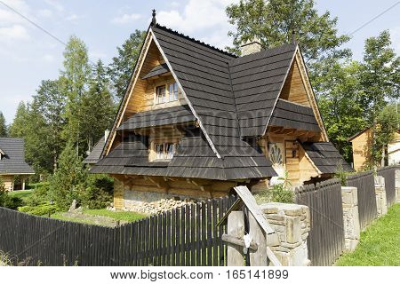 ZAKOPANE POLAND - SEPTEMBER 12 2016: Wooden house called Krzesanica a hut with a sloping roof covered with shingles which emphasize the origin of this highland architecture