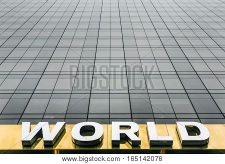 Word World On The Facade Of A Skyscraper