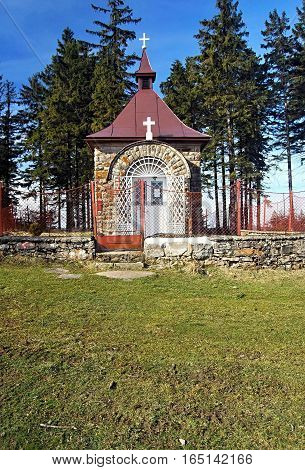 chapel on Murinkovy vrch hill in Moravskoslezske Beskydy mountains on czech-slovakian borders with trees on the background and clear sky