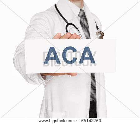 Doctor holding a card with ACA medical concept