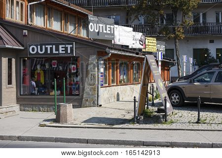 ZAKOPANE POLAND - SEPTEMBER 12 2016: Storefront window in which behind glass is visible sort of goods that is exposed for sale