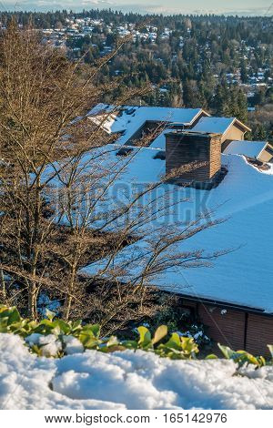Fresh snow covers a rooftop in the Pacific Northwest.