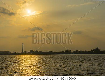 Sunset over small river Tashan' river in Sumskaya oblast Ukraine