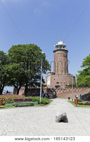 KOLOBRZEG POLAND - JUNE 22 2016: The lighthouse as seen from a land side of a city. It is one of the most recognizable and most visited tourist attractions in the city