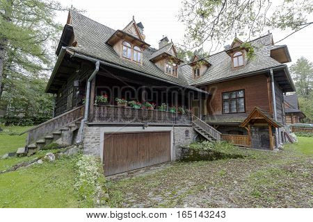 ZAKOPANE POLAND - SEPTEMBER 20 2016: The old historic wooden house is a villa called Ornak. This villa was built in the early twentieth century and is a monument of wooden architecture