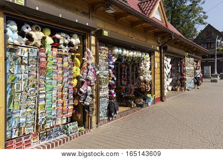 ZAKOPANE POLAND - SEPTEMBER 13 2016: Various maps souvenirs and other small stuff are offered for sale in a few stores that are arranged in a row and are located along the famous pedestrian street