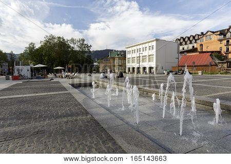 ZAKOPANE POLAND - SEPTEMBER 23 2016: Fountain and view over the Independence Square that is the site of many official ceremonies and cultural events.