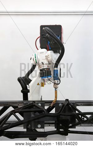Robotic Arm Welding Metal Components in Factory