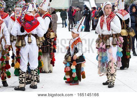 Razlog, Bulgaria - January 14, 2017: People in traditional carnival kuker costumes at Kukeri festival Starchevata