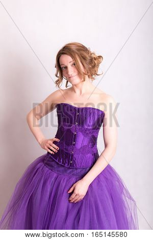 woman in a purple evening gown on white background