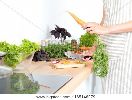 Fresh vegetables on the cutting board are falling in the pot, concept of cooking.