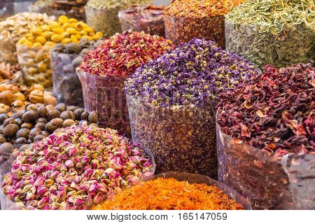 Spices and herbs being sold on street stal at Morocco traditional market.