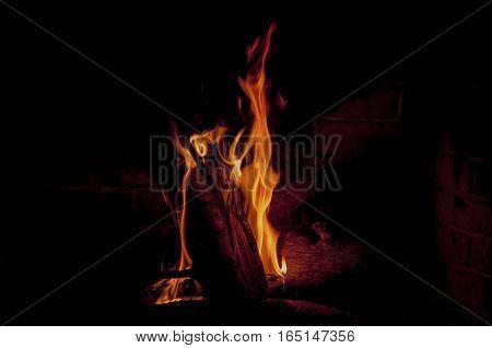 log is burning in fireplace, fire, heat
