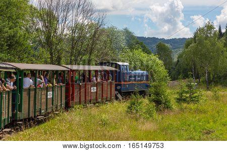 BieszczadyPoland-JULY 142014: Train of Biaszczadzka Railway with tourist heading to Balnica Station