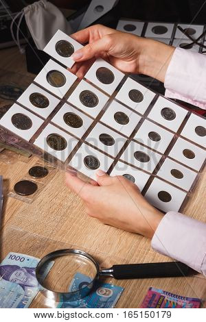 Woman Holds A Set Of Old Coins In The Pockets