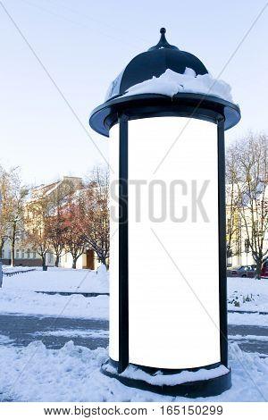 Mockup. Street advertising or information column stand on sidewalk at winter