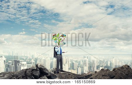 Faceless businessman outdoor with drawn growth concept instead of head