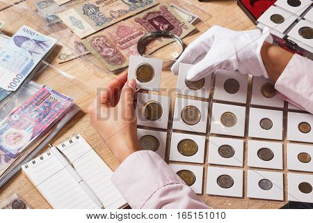 Woman Holds A Set Of Old Coins