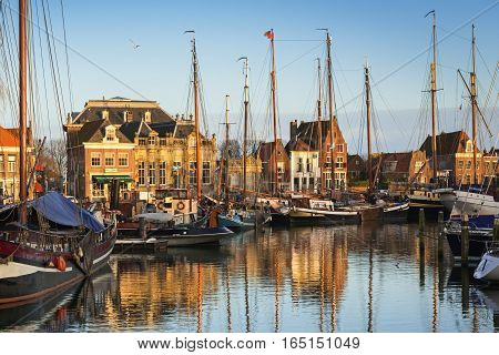ENKHUIZEN, NORTH HOLLAND/ THE NETHERLANDS - JANUARY 10, 2017: View of  the historical part of the city and Oude harbor from the bridge  at the evening, Netherlands