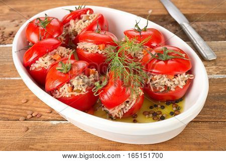 Baked tomatoes stuffed with rice, lentils and carrot.