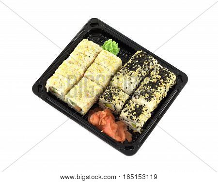Portions of sushi rolls in black plastic container isolated on white diagonal view closeup