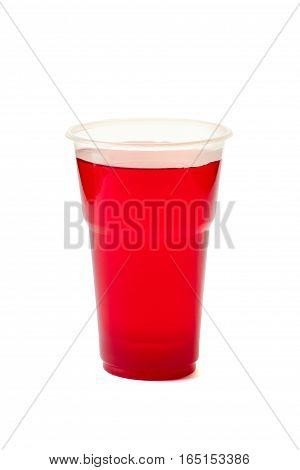 Red drink in plastic cup isolated on white background