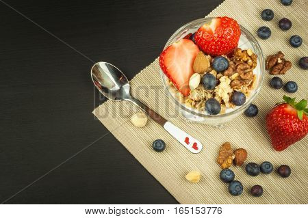 Blueberries and oatmeal. Healthy food for kids. Yogurt and fruit for athletes. Diet food.