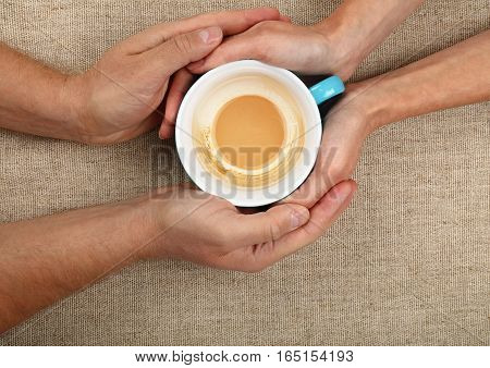 Man And Woman Hands Hold Empty  Latte Coffee Cup