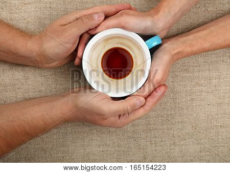 Man And Woman Hands Hold Full Black Coffee Cup