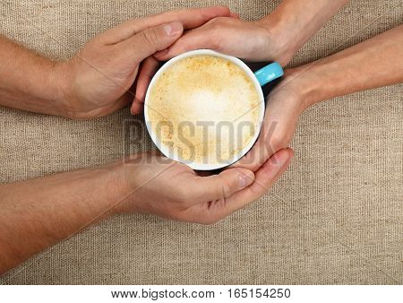 Man And Woman Hands Hold Full Latte Coffee Cup