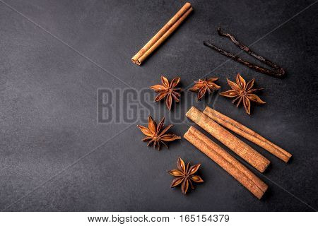 Cinnamon, Vanilla, And Anise On Black Background