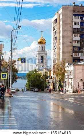 SAMARA RUSSIA - SEPTEMBER 10 2016: View on belltower of Iversky monastery and Volga river in Samara in summer sunny day after the rain
