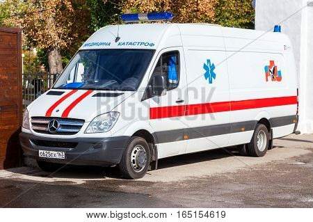 SAMARA RUSSIA - SEPTEMBER 10 2016: Ambulance car parked up in the street. Text in russian: