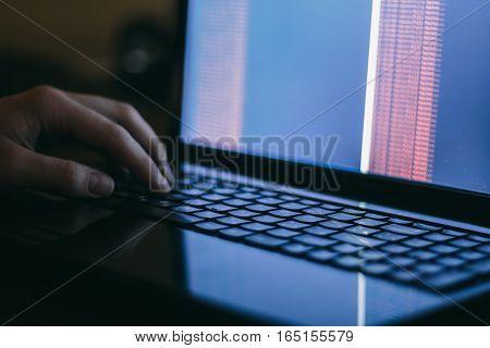 hacker hacking the server in the dark
