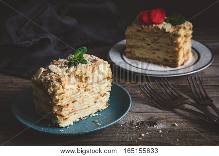 Napoleon cake - multi layered cake with pastry cream. Low key image, food still life, rustic style