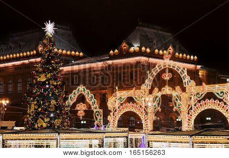 Decorations with Christmas tree and fair to New Year celebration at the Manege Square, Moscow, Russia