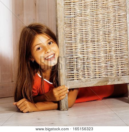 real little cute brunette girl at home smiling close up, real interior
