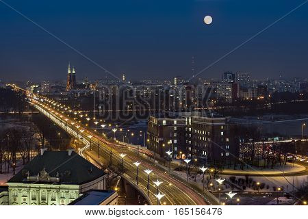 Full moon over Warsaw city in winter time Poland