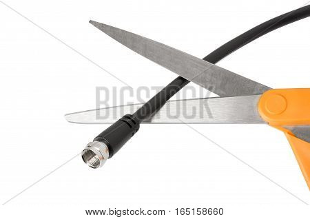 Scissors about to cut a coaxial cable - cutting the cord cable TV concept