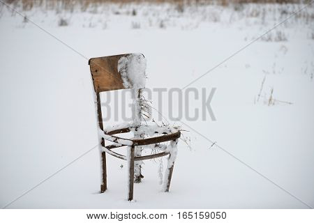 Abandoned, Broken, Broken-down Old Wooden Chair In The Winter In Nature